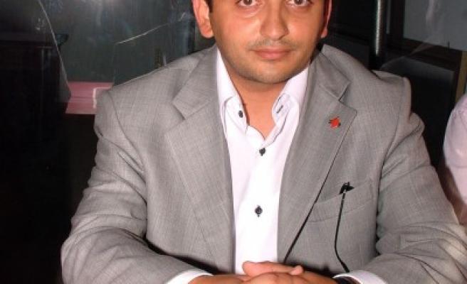 MHP İlçe'den DP İlçe'ye 'Hayırlı olsun' ziyareti