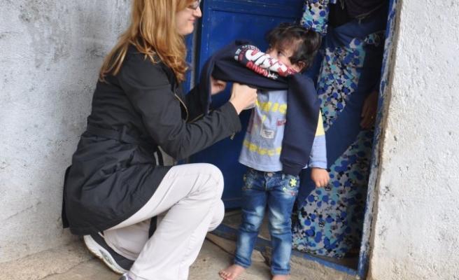 Suriyelilere kışlık kıyafet yardımı
