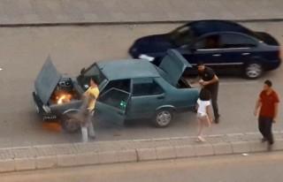 Otomobil kırmızı ışıkta alev aldı
